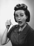 Woman Holding Ladle, Licking Lips, Portrait