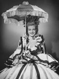 Woman Wearing Colonial Style Dress Posing in Studio, Portrait
