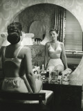 Woman in Underwear Sitting in Front of Vanity Table, Rear View