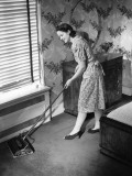 Housewife Using Carpet Sweeper in Home
