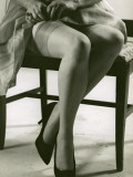 Woman With Silk Stockings Fixes Garter