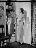 Woman Taking Dress From Wardrobe