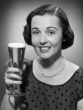 Woman Raising a Glass of Beer
