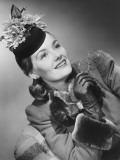 Woman in Fancy Hat Posing in Studio