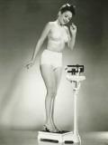 Woman in Underwear Standing on Scale