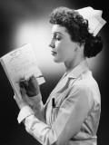 Young Nurse Writing on File in Studio