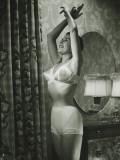 Woman in Underwear Stretching in Bedroom