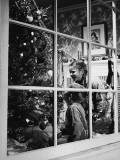 Boy and Girl (3-8) Looking at Christmas Tree