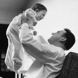 Man Raising Baby Over Head