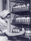 Female Nurse Taking Bottle