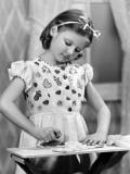 Girl (7-9) Using Toy Iron (B&W)