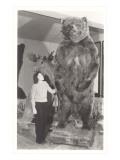 Woman Standing by Large Stufffed Bear
