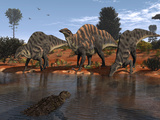 Ouranosaurus Drink at a Watering Hole While a Sarcosuchus Floats Nearby