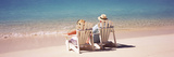 Couple Sitting in Adirondack Chairs on the Beach, Bahamas