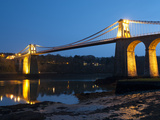 Menai Bridge Illuminated at Dusk, Gwynedd, Anglesey, North Wales, Wales, United Kingdom, Europe