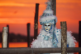 A Woman in Mask and Costume for Carnival At Sunrise