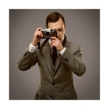 Businessman With A Retro Camera