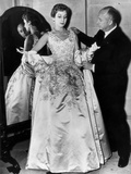 Christian Dior Arranging One of His Dresses