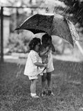 Two Children under Umbrella During a Downpour