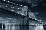 Brooklyn Bridge over East River at Night in Black and White in New York City Manhattan with Lights