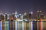 New York City Manhattan Midtown Skyline at Night with Lights Reflection over Hudson River Viewed Fr
