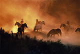 E0999 Cowboys and Horses in a Field at Sunset