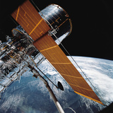 The Hubble Space Telescope Backdropped by Planet Earth