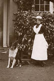 Woman with Collie Dog in a Garden