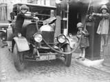 Kids Refuelling a Car
