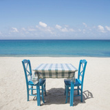 Restaurant Table and Chairs on Beach in Greece