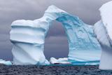 Huge Arch Shaped Iceberg in Antarctica