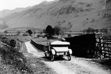 A Vintage Car Travelling Along a Lane Through the Lake District, Cumbria, 1920s
