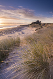 Sunrise over Bamburgh Castle, Northumberland, England. Spring