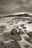 Dunstanburgh Castle at Dawn from Embleton Bay, Northumberland, England. Spring (April)