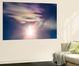 Iridescent Clouds Near the Sun