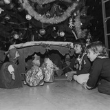 Children Sitting under the Greek Tree at the Annual Christmas around the World Festival