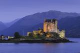 Eilean Donan Castle Floodlit at Night on Loch Duich, Scotland, United Kingdom
