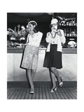 Two Models Standing at a Bar Counter, Smoking and Drinking Coffee