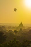 Myanmar. Bagan. Hot Air Balloons Rising over the Temples of Bagan