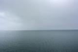 Norway. Svalbard. Hornsund. Heavy Clouds over the Calm Water