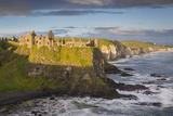 Sunrise over Dunluce Castle Along Northern Coast of County Antrim, Northern Ireland, Uk