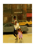 Woman and Child Walking Down City Sidewalk