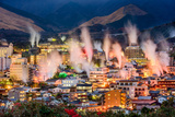 Beppu, Japan Cityscape with Hot Spring Bath Houses with Rising Steam