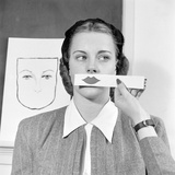 Young Woman at Stephens College Sampling Different Shades of Lipstick, Columbia, Missouri, 1945