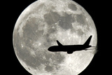 A Jet Plane Passes in Front of the Full Moon Above Surfside, Fla. Wall Mural