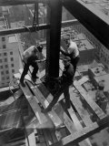 Workmen Attach Steel Beams Above Street During Construction of the Manhattan Company Building Photographic Print by Arthur Gerlach