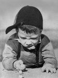 Boy Engrossed in Playing Migs Impressão fotográfica
