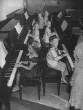 Children Taking Piano Lessons Impressão fotográfica por George Strock