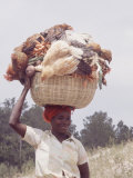 Haitian Woman Carrying Large Basket with Her Market Shopping on Her Head Photographic Print by Lynn Pelham