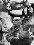 Korean Mother Nursing Her Baby, Carrying All Her Belongings in a Wash Basin, Retreating from Seoul Photographic Print by Carl Mydans